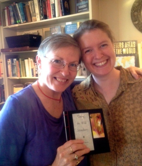 Author and artist Nancy Maxson, holding her new book, with printer and bookbinder Emily Hancock of St Brigid Press, at Maxson's reception at Stone Soup Books and Cafe, Waynesboro, Va, on Saturday, June 29th, 2013.