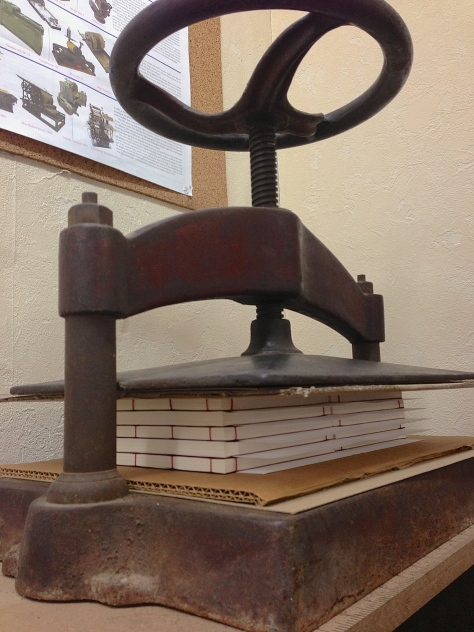 "10 finished editions of the book, ""resting"" overnight in the nipping press."