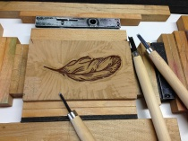 Hand-carving the feather (shown here highlighted with the warm-brown ink).