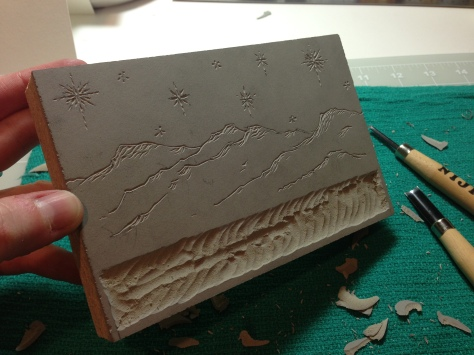 Hand-carved mountains and stars, by Emily Hancock.