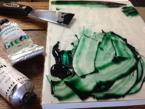 Hand-mixing the deep green oil-based ink for the front (poem-side) of the coasters.