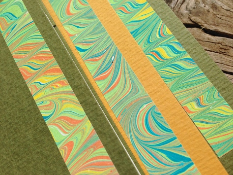 Close-up of the SlimGems' covers, with hand-marbled paper decorations.