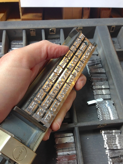 Handsetting the type for the broadside, letter-by-letter and space-by-space.