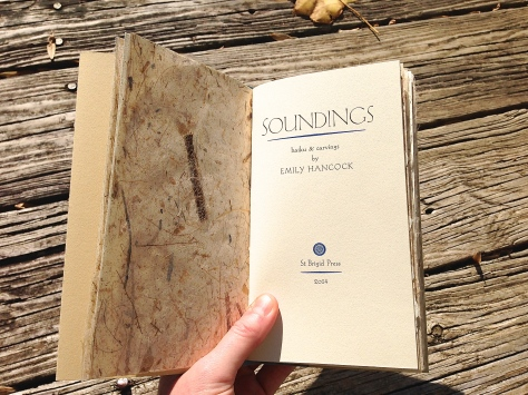 The title page of Soundings, on cream-colored Rives paper, with banana-leaf decorative paper facing.