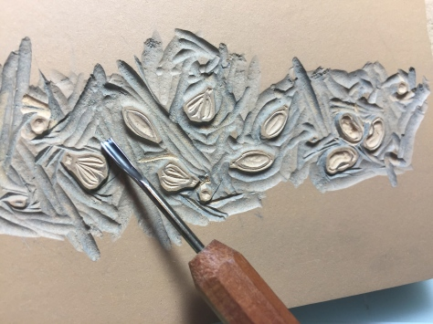 Hand carving the poem's seeds in a linoleum block.